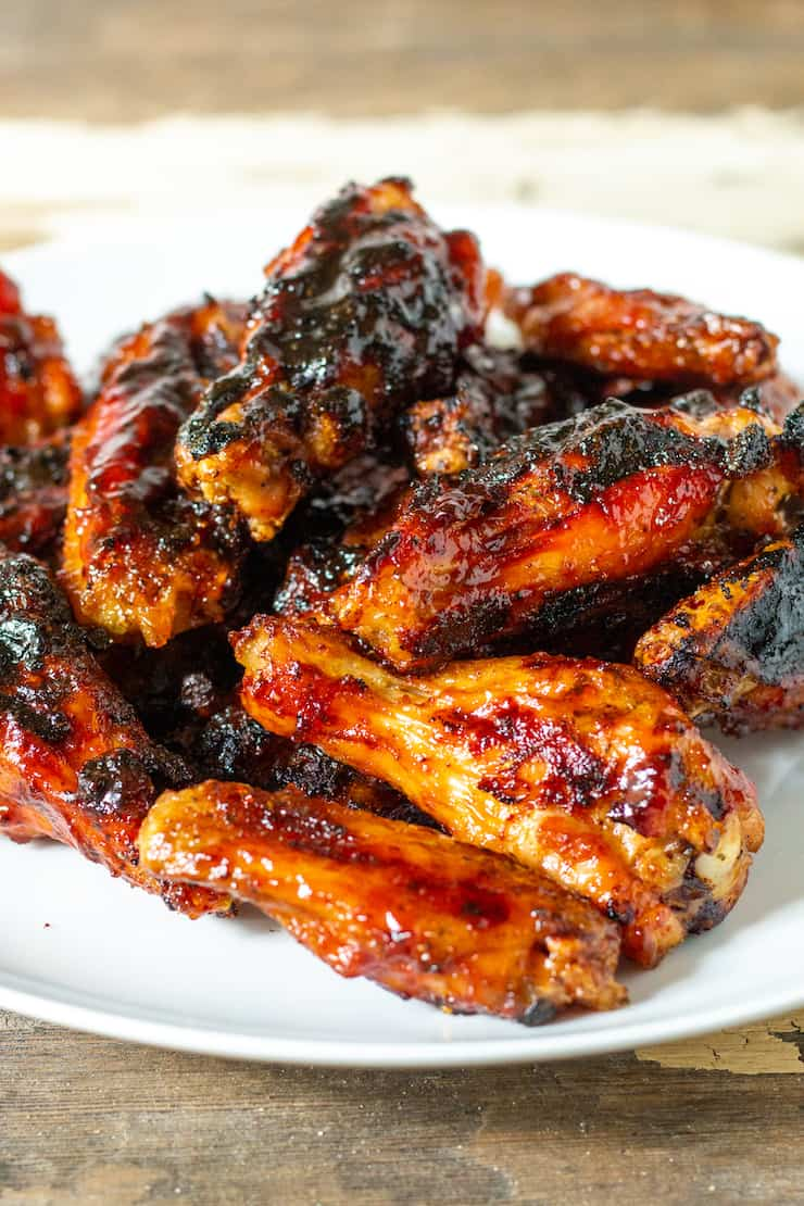 Grilled wings on a serving plate.