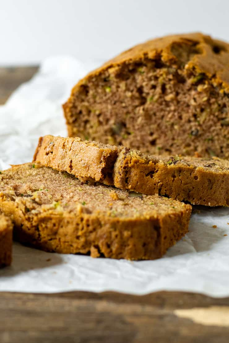 Zucchini bread loaf with two slices.