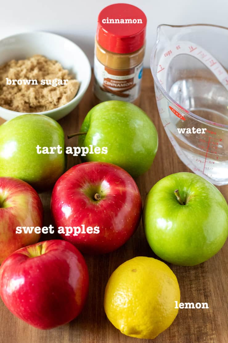 Ingredients for Instant Pot applesauce labeled on cutting board.