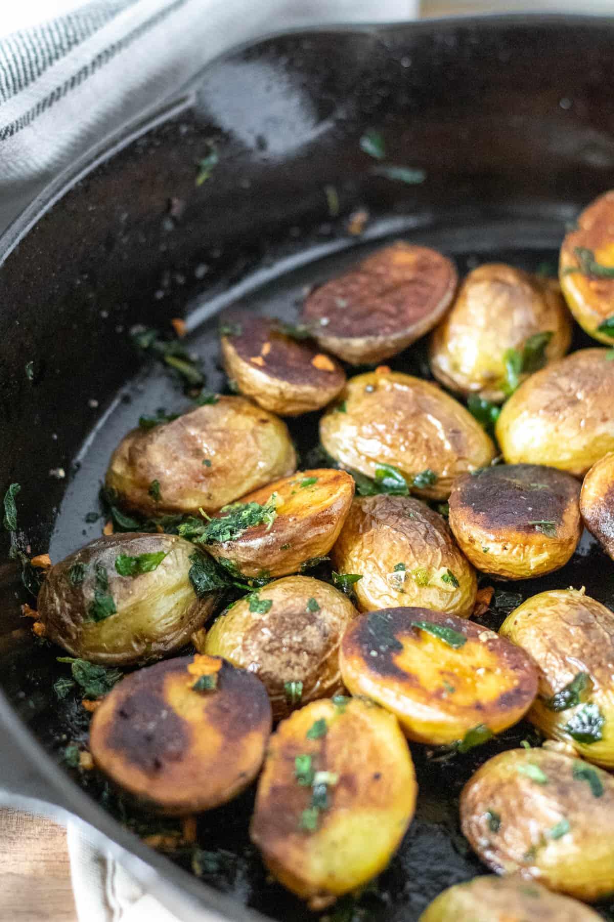 Crispy skillet potatoes in cast iron pan.