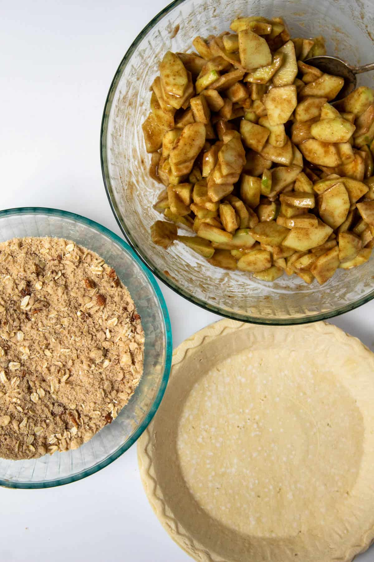 Apple pie filling, streusel topping and frozen pie shell ready to assemble.