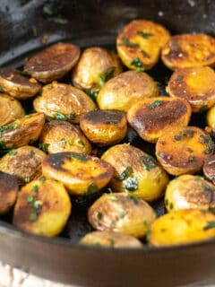 Skillet fried potatoes finished in cast iron skillet.